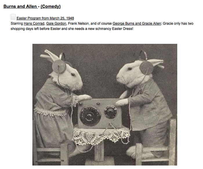 Believe it or not, this is a photo of two bunnies dressed in clothing, standing on miniature chairs at a table with radio equipment on it. Of course, they are wearing earphones.