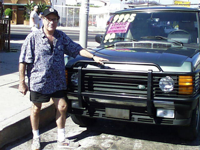 A 2001 photo of Bill in front of our Range Rover, which is now back on the East Coast.