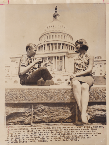 I am a working reporter! Interviewing a spelling-bee contestant in front of the Capital building.